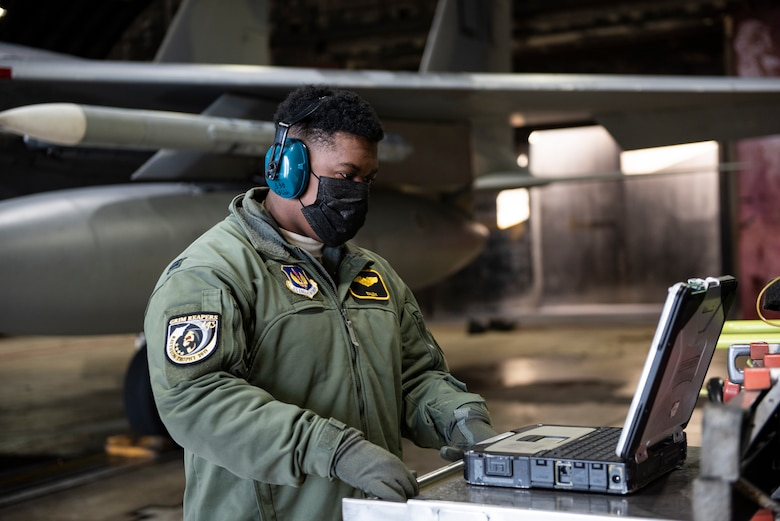 U.S. Air Force Capt. Joshua Jones, 493rd Fighter Squadron F-15C Eagle pilot, assists with pre-flight checks at Royal Air Force Lakenheath, England, Jan. 21, 2021. Aircrew and other Airmen and Aircrew from non-maintenance career fields recently had the opportunity to practice Agile Combat Employment concepts while helping generate sorties for the 493rd FS. (U.S. Air Force photo by Airman 1st Class Jessi Monte)