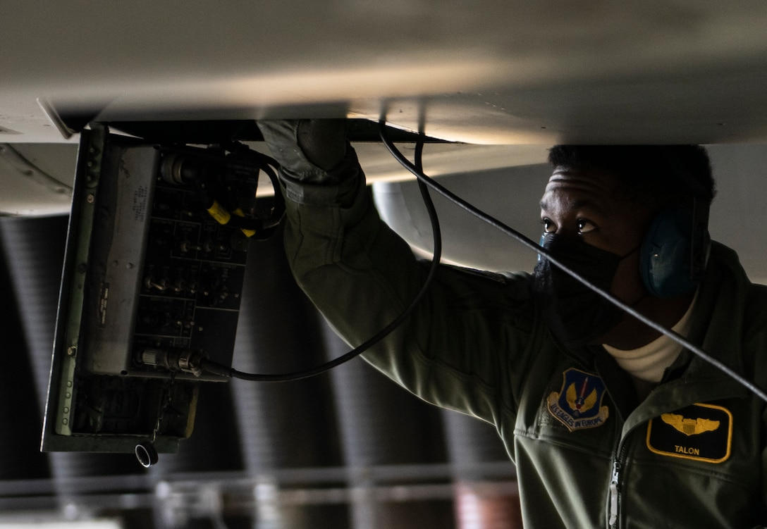 U.S. Air Force Capt. Joshua Jones, 493rd Fighter Squadron F-15C Eagle pilot, removes the communications cable from an aircraft prior to take-off at Royal Air Force Lakenheath, England, Jan. 21, 2021. The 48th Fighter Wing is dedicated to developing a force of multi-capable Airmen to drive the mission more effectively through the integration of Agile Combat Employment concepts. (U.S. Air Force photo by Airman 1st Class Jessi Monte)