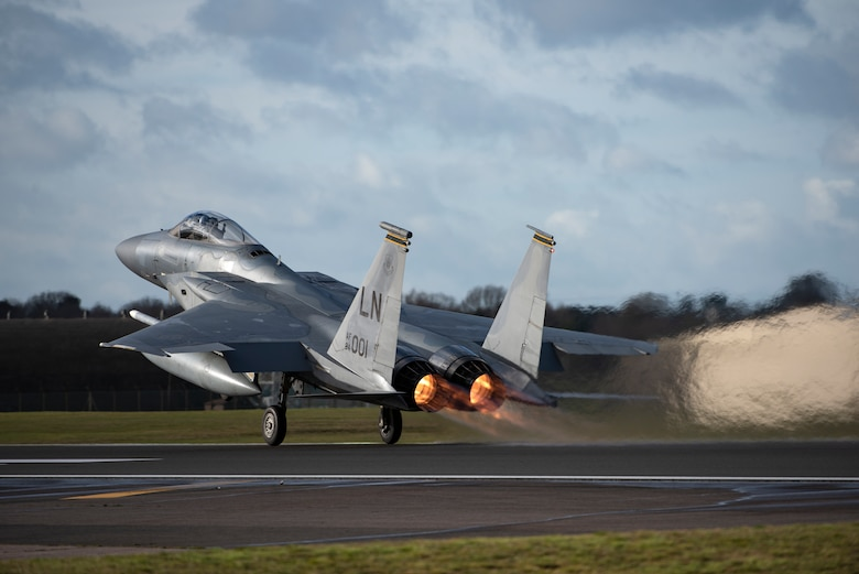 An F-15C Eagle assigned to the 493rd Fighter Squadron takes off at Royal Air Force Lakenheath, England, Jan. 21, 2021. Aircrew and other Airmen and Aircrew from non-maintenance career fields recently had the opportunity to practice Agile Combat Employment concepts while helping generate sorties for the 493rd FS. (U.S. Air Force photo by Airman 1st Class Jessi Monte)