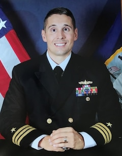 Studio portrait of Cmdr. Matthew T. Erdner.
