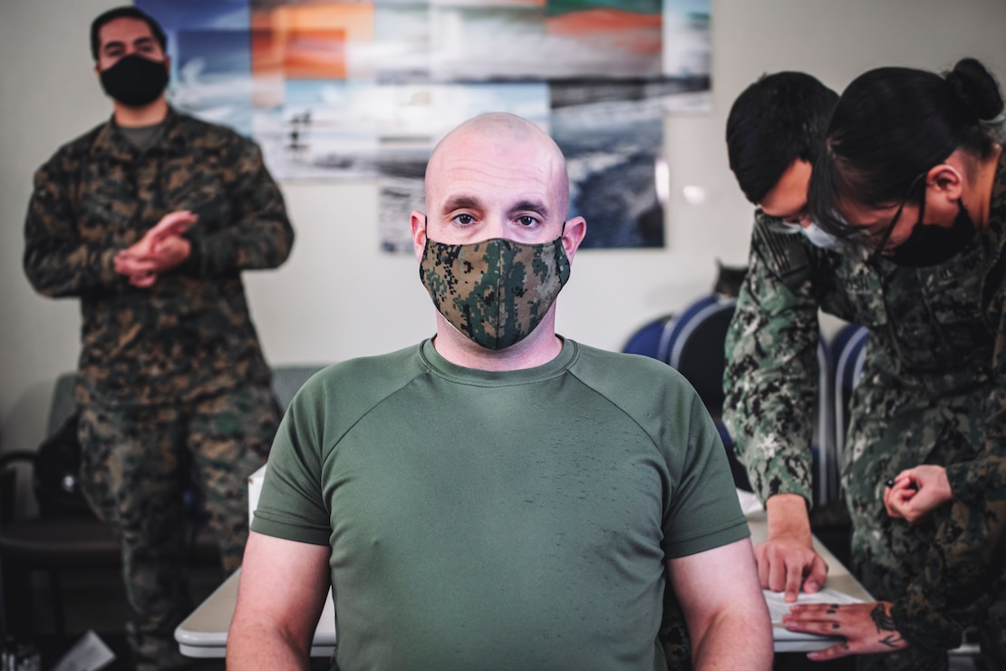 U.S. Marine Corps Sgt. Maj. Travis DeBarr, sergeant major of the 11th Marine Expeditionary Unit, waits to receive the Pfizer-BioNTech COVID-19 vaccine at Naval Hospital Camp Pendleton, California, Jan. 11, 2021. The 11th MEU is one of the first units with I Marine Expeditionary Force to be allocated the vaccine due to its upcoming deployment. The vaccine was authorized for emergency use by the U.S. Food and Drug Administration and is voluntary to receive. (U.S. Marine Corps photo by Staff Sgt. Donald Holbert)