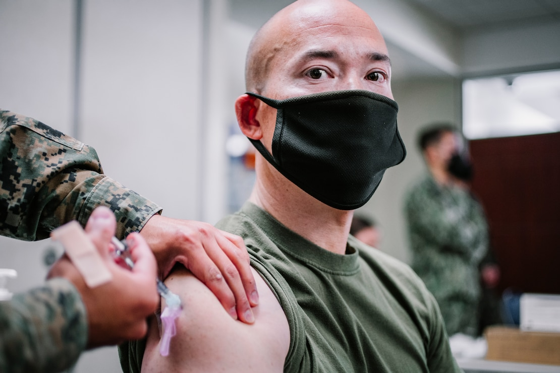 U.S. Marine Corps Lt. Col. Le Nolan, executive officer of the 11th Marine Expeditionary Unit, receives the Pfizer-BioNTech COVID-19 vaccine at Naval Hospital Camp Pendleton, California, Jan. 11, 2021. The 11th MEU is one of the first units with I Marine Expeditionary Force to be allocated the vaccine due to its upcoming deployment. The vaccine was authorized for emergency use by the U.S. Food and Drug Administration and is voluntary to receive. (U.S. Marine Corps photo by Staff Sgt. Donald Holbert)