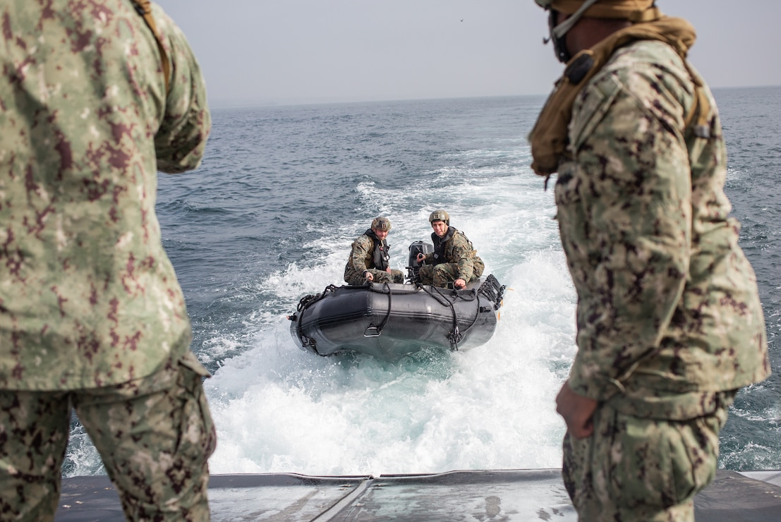 U.S. Marines with the All Domain Reconnaissance Detachment, 11th Marine Expeditionary Unit (MEU), operate a Combat Rubber Raiding Craft (CRRC) onto a Mark VI patrol boat assigned to Maritime Expeditionary Security Squadron 3, during a combatant dive exercise at Marine Corps Base Camp Pendleton, California, Jan. 6, 2020. The training improved proficiency utilizing CRRCs for insertion and extraction during combatant dive operations, and improved interoperability working with the Mark VI patrol boat platform to facilitate potential special mission requirements on the 11th MEU's upcoming deployment. (U.S. Marine Corps photo by Sgt. Jennessa Davey)