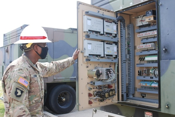 Staff Sgt. Russell Gaskin, U.S. Army Prime Power School instructor, reviews an electrical panel during the Prime Power Capstone Training Exercise at the Contingency Basing Integration Training and Evaluation Center (CBITEC) in Fort Leonard Wood, Mo., Aug. 11, 2020. Prime Power School students are tested at the CBITEC on the knowledge, skills and abilities they gained over the year-long course to become prime power specialists. CBITEC is a U.S. Army Engineer Research and Development Center, Construction Engineering Research Laboratory facility that supports the operational energy continuum and safely trains the warfighter to tackle the nation's power challenges.