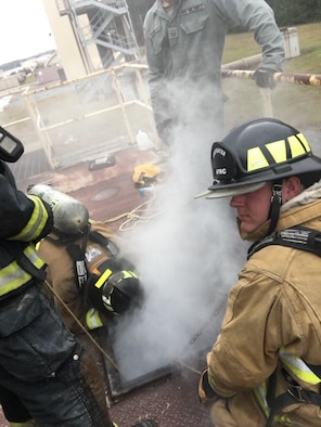 Master Sgt. Aaron Brindamour 914th Civil Engineer Squadron, training manager,  instructs sub-floor rescue during Firefighter Rescue and Survival Course at Dobbins Air Reserve Base, Georgia on 8 November, 2018. The goal of the Firefighter Rescue and Survival Course to refine the life-saving skills necessary to fight fires safely and effectively
