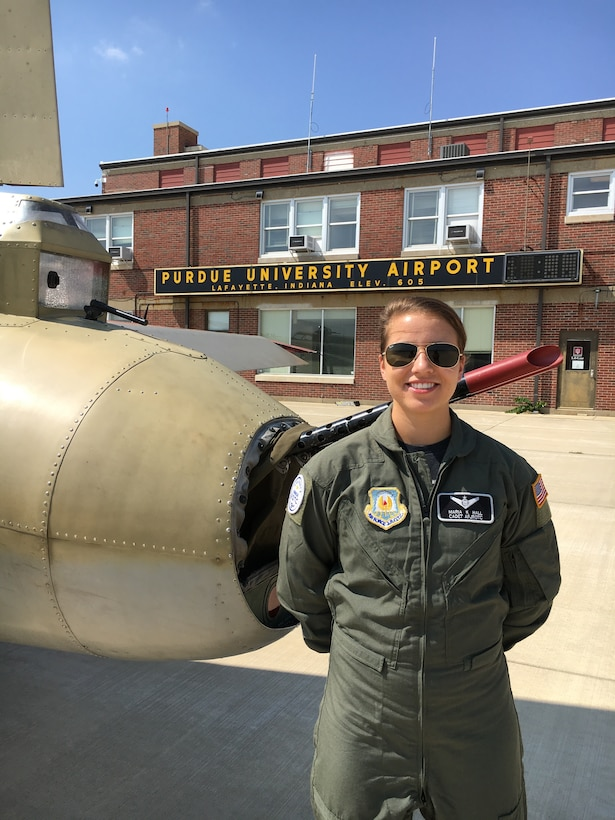 Former Air Force Junior ROTC Cadet Maria Hall, TX-20063, stands in front of a vintage aircraft at the Purdue University Airport as part of the college's 2018 Flight Academy class. She currently attends Texas A&M University as a sophomore engineering major and contracted Air Force ROTC cadet at Detachment 805. She said the Flight Academy has allowed her to continue to fly and pursue an instrument rating.
