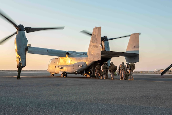 U.S. Marines with 3rd Battalion, 1st Marines, assigned to Special Purpose Marine-Air Ground Task Force – Crisis Response - Central Command, board an MV-22 Osprey during a crisis response exercise in Kuwait, Jan. 13, 2021. The regularly scheduled exercise was designed to sustain proficiency and enhance MAGTF integration in a realistic training environment. The SPMAGTF-CR-CC is a crisis response force, prepared to deploy a variety of capabilities across the region.  (U.S. Marine Corps Photo by Lance Cpl. Jacob Yost)