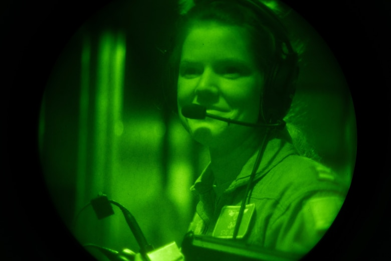 """Capt. Staci Wilde, 9th Airlift Squadron pilot, prepares for a seat swap during a C-5M Super Galaxy night training sortie, Jan. 19, 2021, at Dover Air Force Base, Delaware. The 9th AS, also known as the """"Proud Pelicans,"""" routinely flies local training missions to maintain operational readiness in support of the nation's outsized global airlift capability. (U.S. Air Force photo by Airman 1st Class Faith Schaefer)"""