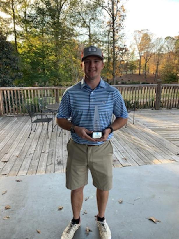 Air National Guard Tech. Sgt. Stephen Standridge holds golf trophy.
