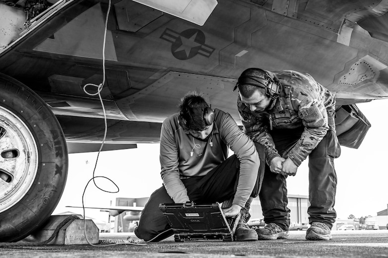 An Airman instructs another Airman during training.