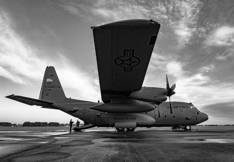 An aircraft sits on the flight line.