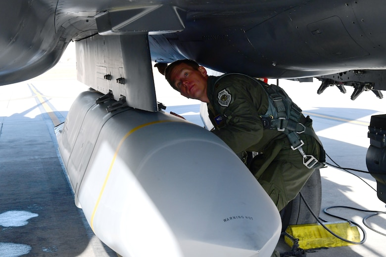 Maj. Ryan Mobley, 706th Fighter Squadron assistant director of operations and F-15E test director, prepares to conduct an AGM-158B Joint Air-to-Surface Standoff Missile drop from an F-15E, Jan. 7, Nellis Air Force Base, Nev. While the F-15E is the leading delivery platform for JASSM in the Area of Responsibility, the missile release at White Sands Missile Range, New Mexico, was the first JASSM dropped by any unit from Nellis AFB.