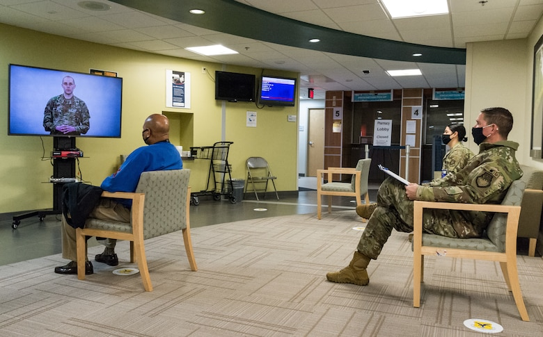 Col. Shanon Anderson, 436th Airlift Wing vice commander, watches an informational video prior to receiving the COVID-19 vaccination Jan. 20, 2021, at Dover Air Force Base, Delaware. Anderson was among the first Team Dover senior leaders who received the vaccine in accordance with Department of Defense guidance. The vaccine was granted emergency use authorization by the U.S. Food and Drug Administration for use in prevention of COVID-19. (U.S. Air Force photo by Roland Balik)