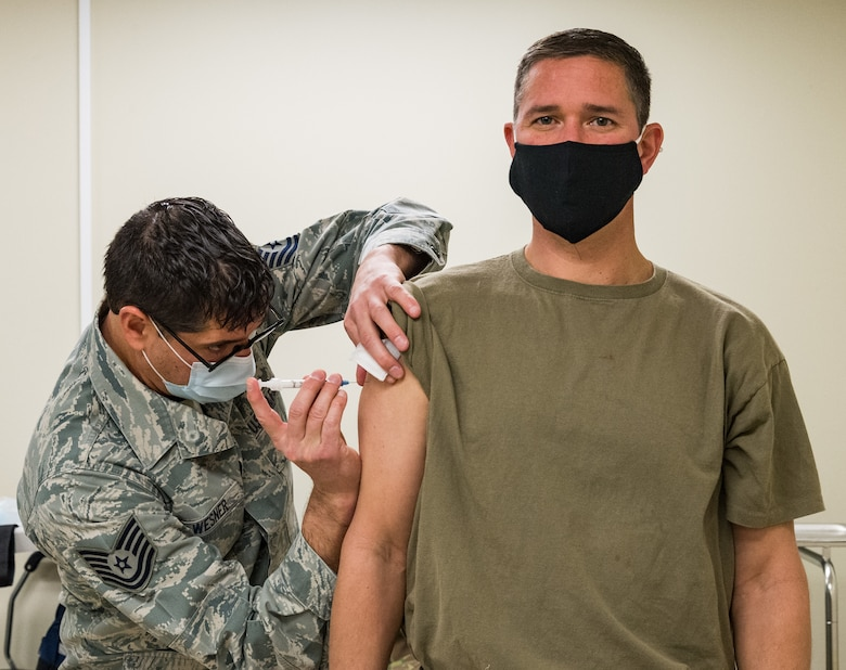 Tech. Sgt. John Wesner, 512th Aerospace Medicine Squadron immunizations noncommissioned officer in charge, administers the COVID-19 vaccine for Col. Shanon Anderson, 436th Airlift Wing vice commander, Jan. 20, 2021, at Dover Air Force Base, Delaware. Anderson was among the first Team Dover senior leaders who voluntarily received the vaccine in accordance with Department of Defense guidance. The vaccine was granted emergency use authorization by the U.S. Food and Drug Administration for use in prevention of COVID-19. (U.S. Air Force photo by Roland Balik)
