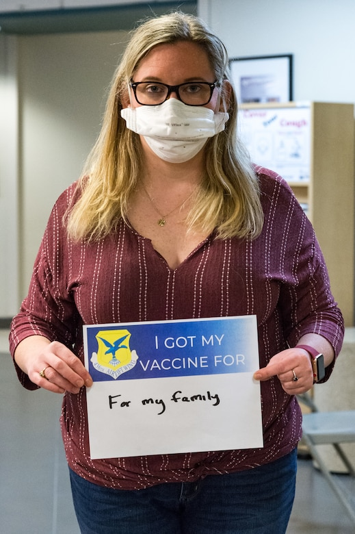 Kathleen McBride, 436th Operational Medical Readiness Squadron aerospace technician, displays a sign stating why she volunteered for the COVID-19 vaccine on Jan. 21, 2021, at Dover Air Force Base, Delaware. McBride was among the first Team Dover front-line workers who voluntarily received the vaccine in accordance with Department of Defense guidance. The vaccine was granted emergency use authorization by the U.S. Food and Drug Administration for use in prevention of COVID-19. (U.S. Air Force photo by Roland Balik)