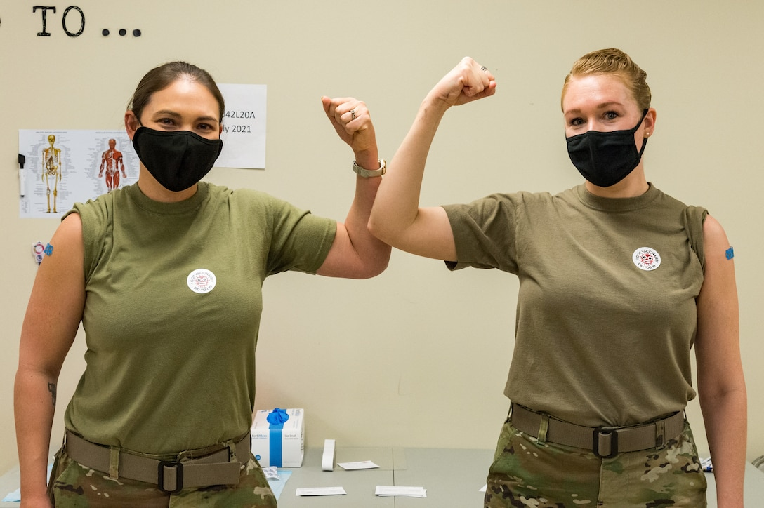 Lt. Col. Kristen Carter, 436th Medical Support Squadron commander, and Master Sgt. Jessica Nienhueser, 436th MDSS superintendent, pose for a photo after receiving the COVID-19 vaccination Jan. 21, 2021, at Dover Air Force Base, Delaware. Carter and Nienhueser were among the first Team Dover front-line workers who voluntarily received the vaccine in concurrence with Department of Defense guidance. The vaccine was granted emergency use authorization by the U.S. Food and Drug Administration for use in prevention of COVID-19. (U.S. Air Force photo by Roland Balik)