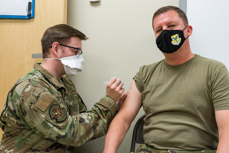 Col. Matthew Jones, 436th Airlift Wing commander, receives the COVID-19 vaccine administered by Staff Sgt. Logan Hallman, 436th Healthcare Operations Squadron education and training noncommissioned officer in charge, Jan. 22, 2021, at Dover Air Force Base, Delaware. Jones was among the first Team Dover senior leaders who voluntarily received the vaccine in accordance with Department of Defense guidance. (U.S. Air Force photo by Roland Balik)