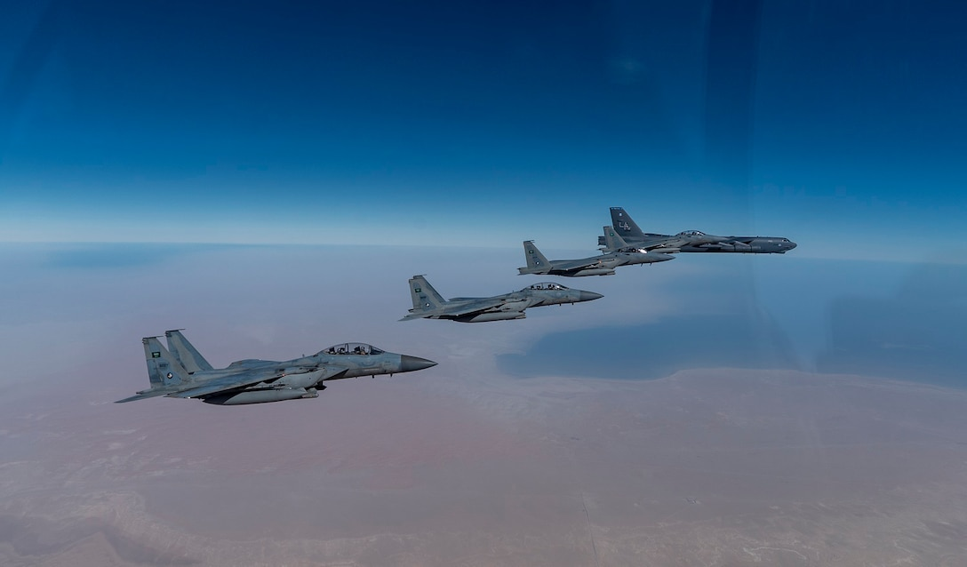 A U.S. Air Force B-52 Stratofortress  from the 2nd Bomb Wing, Barksdale Air Force Base, LA, flew with Royal Saudi Arabian Air Force F-15SAs during a bomber task force mission over the U.S. Central Command area of responsibility, Jan. 27, 2021. The bomber deployment underscores the U.S. Military's commitment to regional security and demonstrates a unique ability to rapidly deploy on short notice. The B-52 is a long-range, heavy bomber that is capable of flying at high subsonic speeds of altitudes of up to 50,000 feet and provides the United States with a global strike capability. (U.S. Air Force photo by Senior Airman Roslyn Ward)