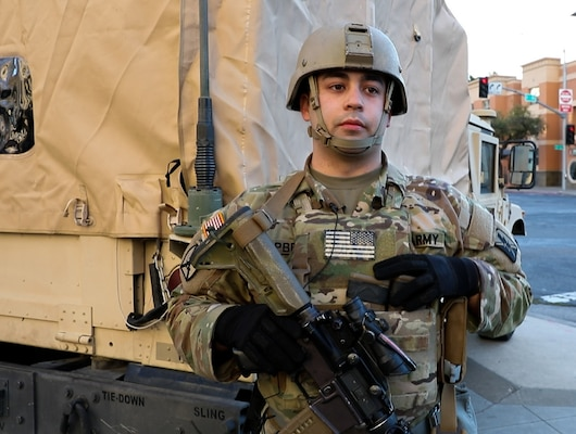 U.S. Army Cpl. David Campbell, an infantryman with the California National Guard's Headquarters and Headquarters Company, 1st Battalion, 184th Infantry Regiment, provided aid at the scene of a car accident while guarding the Robert T. Matsui United States Courthouse in Sacramento, California., Jan. 19, 2021. Campbell received recognition and a division coin from U.S. Army Col. Robert Wooldridge, deputy commander for support , 40th Infantry Division.