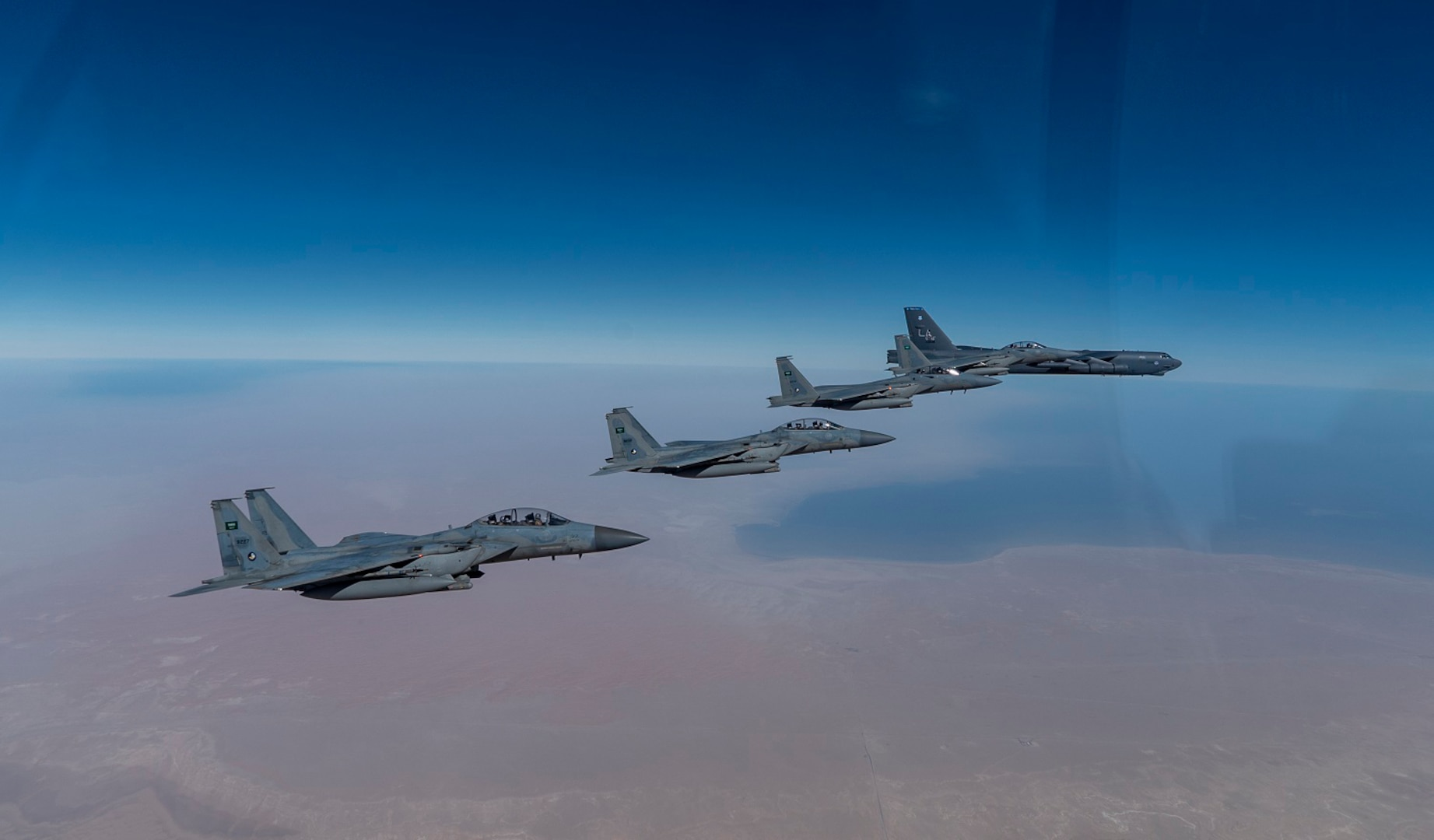 A U.S. Air Force B-52 Stratofortress  from the 2nd Bomb Wing, Barksdale Air Force Base, LA, flew with Royal Saudi Arabian Air Force F-15SAs during a bomber task force mission over the U.S. Central Command area of responsibility, Jan. 27, 2021. The bomber deployment underscores the U.S. Military's commitment to regional security and demonstrates a unique ability to rapidly deploy on short notice. The B-52 is a long-range, heavy bomber that is capable of flying at high subsonic speeds of altitudes of up to 50,000 feet and provides the United States with a global strike capability.