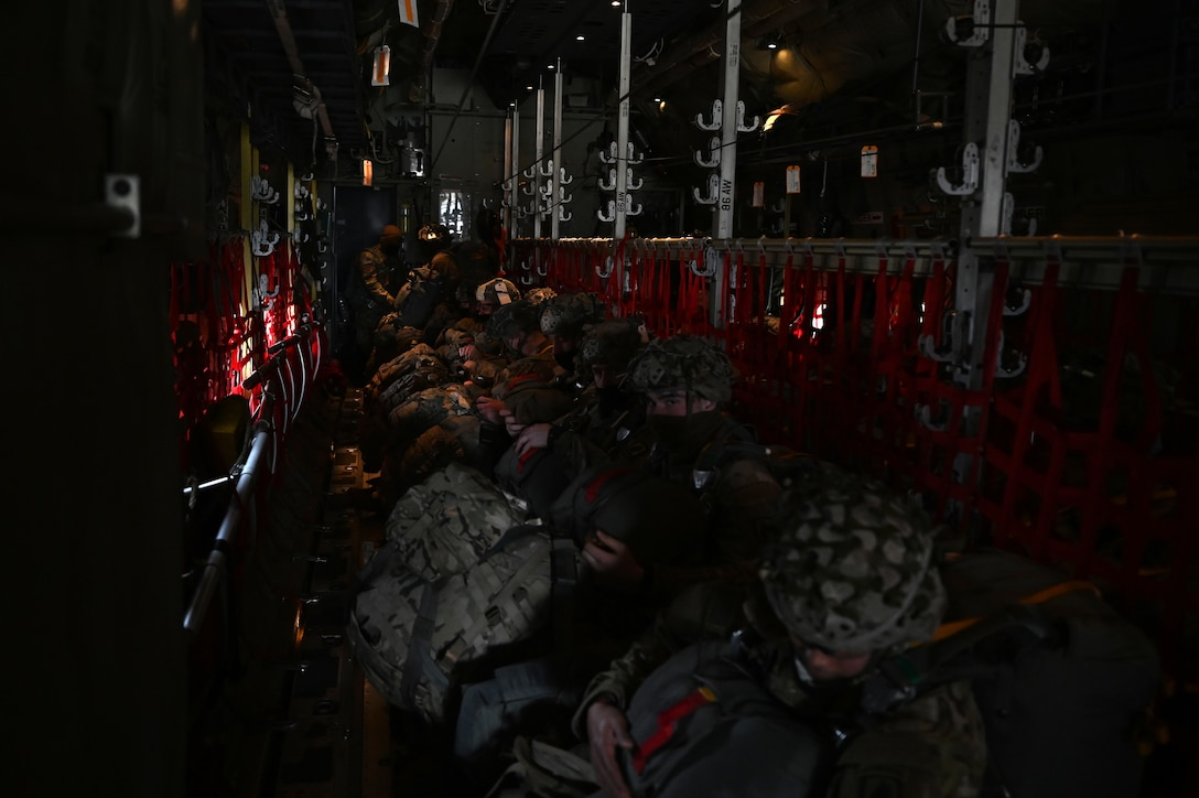 U.S. Army paratroopers assigned to the 1st Squadron (Airborne), 91st Cavalry Regiment, 173rd Airborne Brigade, assigned to Grafenwoehr Training Area, Germany, sit in a U.S. Air Force C-130J Super Hercules aircraft prior to a military static line jump.