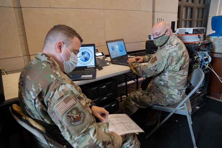 U.S. Airmen with the Louisiana Air National Guard's 159th Fighter Wing and 236th Combat Communications Squadron set up communications equipment in the U.S. Capitol building in Washington, D.C., to ensure inter-operability with federal and district partners as part ofsupport to the 59th Presidential Inauguration, Jan. 18, 2021. At least 25,000 National Guard men and women have been authorized to conduct security, communication and logistical missions in support of federal and District authorities leading up and through the inauguration. (U.S. Army National Guard photo by Staff Sgt. Josiah Pugh)