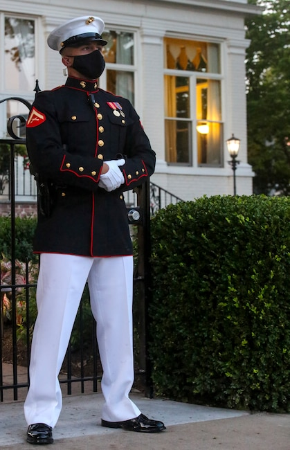 A Marine with Guard Company, Marine Barracks Washington, D.C., stands his post outside of the Home of the Commandants