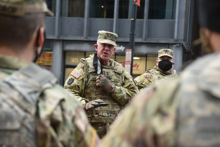 U.S. Army Maj. Gen. Mark J. Schindler, acting adjutant general of Pennsylvania, and Command Sgt. Maj. Jon Worley, senior enlisted adviser to the adjutant general, talk with Pennsylvania National Guard members who are supporting the inauguration efforts in Washington, D.C., on Jan. 17, 2021.