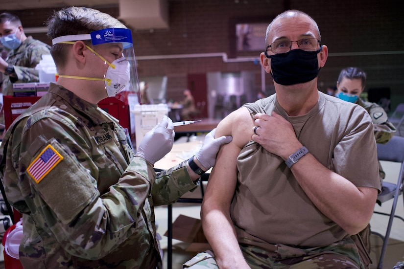 A service member gets the vaccine.
