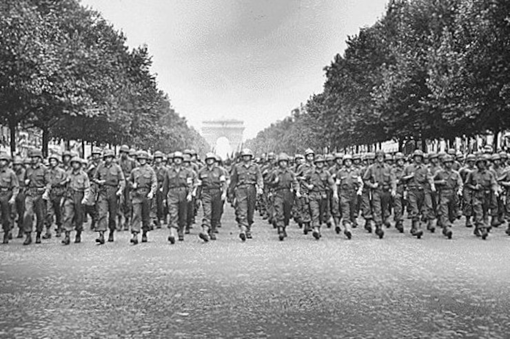 Soldiers from Pennsylvania's 28th Infantry Division march down the Champs-Elysees on Aug. 29, 1944, following the liberation of Paris during World War II.