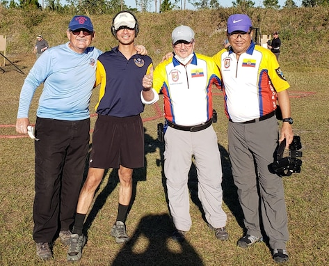 The United States Practical Shooting Association attracts shooters from other countries. Lt. Col. Koh poses with the Ecuador Team at the Florida Sectional Championship.