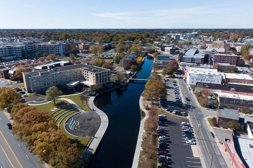 An aerial view of a river that runs through a downtown area.