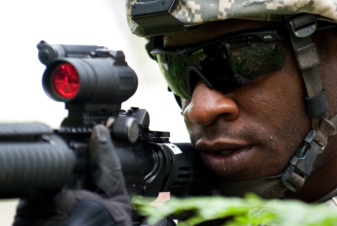 Staff Sgt. Austin Esotu, a member of the 122nd Security Forces Squadron, 122nd Fighter Wing, Fort Wayne, Ind., keeps an eye out for enemy combatants during a reconnaissance exercise, July 28, 2015, at the Combat Readiness Training Center, Alpena, Mich. Airmen from the 122nd Fighter Wing were training at the CRTC as part of their annual training. (U.S. Air National Guard photo by Staff Sgt. William Hopper)