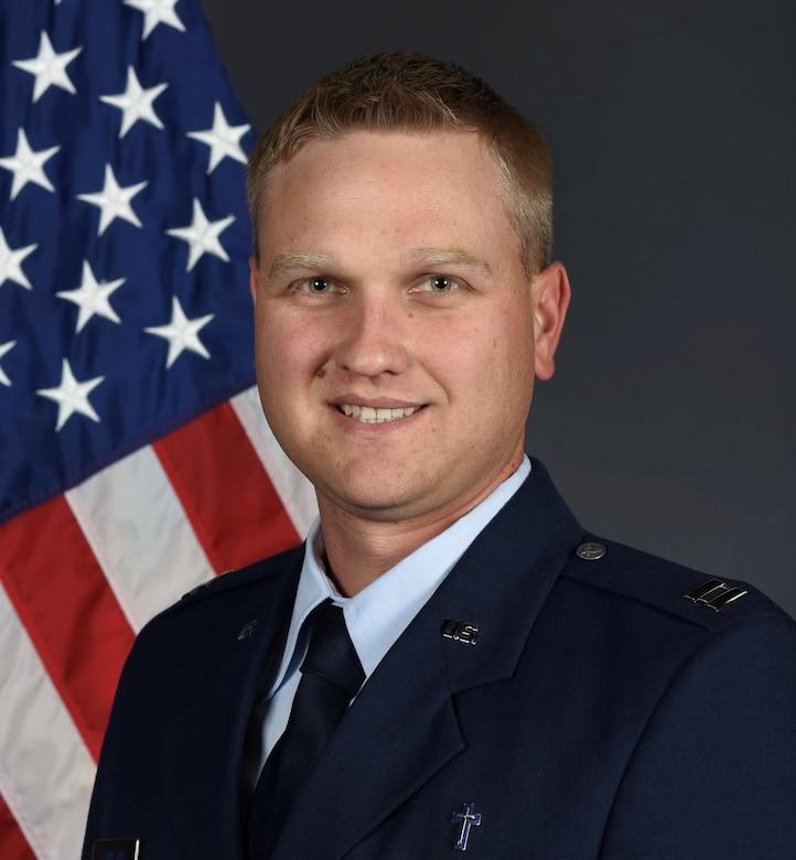 Chaplain Brett Barner poses with a C-130.