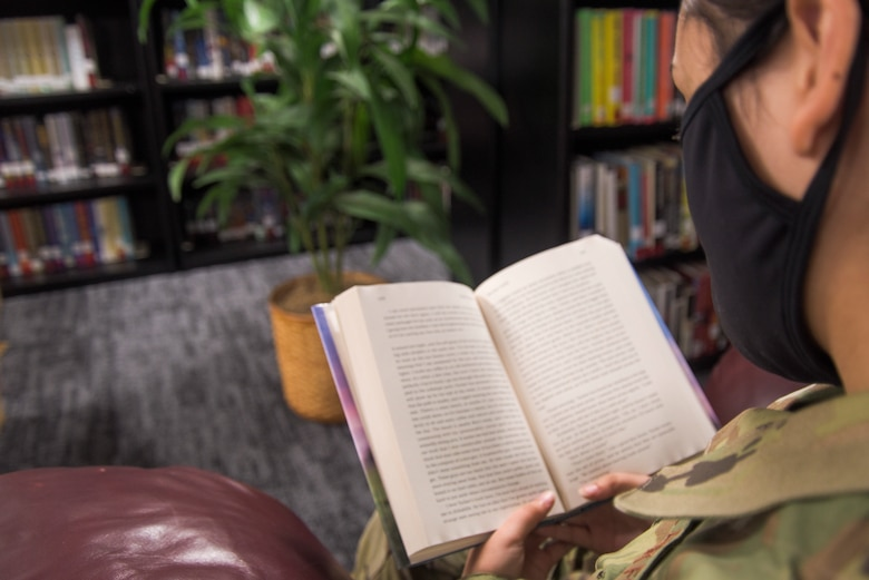Airman 1st Class Anabel Del Valle, 325th Fighter Wing public affairs apprentice, reads a book at the 325th Force Support Squadron base library at Tyndall Air Force Base, Florida, Jan. 27, 2021. The Tyndall library, which has been closed due to relocation since December, will reopen for business Feb. 1. (U.S. Air Force photo by Staff Sgt. Magen M. Reeves)
