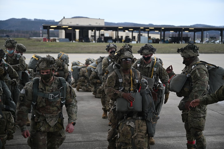 U.S. Army paratroopers assigned to the 1st Squadron (Airborne), 91st Cavalry Regiment, 173rd Airborne Brigade, assigned to Grafenwoehr Training Area, Germany, prepare to board a C-130J Super Hercules aircraft.