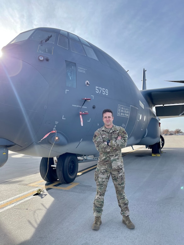 Chaplain Brett Barner poses with a C-130.