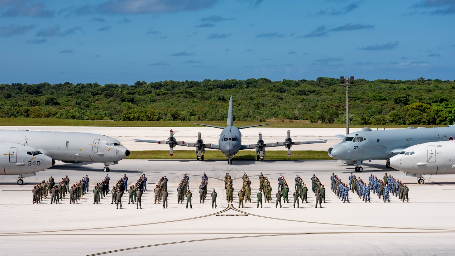 """ANDERSEN AIR FORCE BASE, Guam (Jan. 28, 2021) Members of the Royal Australian Air Force (RAAF), Japan Maritime Self Defense Force (JMSDF), Indian Navy (IN) and the Royal Canadian Air Force (RCAF), along with Patrol Squadron (VP) 5's """"Mad Foxes"""" and VP 8's """"Fighting Tigers"""", pose for a photo at the conclusion of Exercise Sea Dragon. Sea Dragon is an annual multi-lateral anti-submarine warfare exercise that improves the interoperability elements required to effectively and cohesively respond to the defense of a regional contingency in the Indo-Pacific, while continuing to build and strengthen relationships held between nations . As the U.S. Navy's largest forward-deployed fleet, 7th Fleet employs 50 to 70 ships and submarines across the Western Pacific and Indian Oceans. U.S. 7th Fleet routinely operates and interacts with 35 maritime nations while conducting missions to preserve and protect a free and open Indo-Pacific region. (U.S. Navy photo by Lt. Cmdr. Kyle Hooker)"""