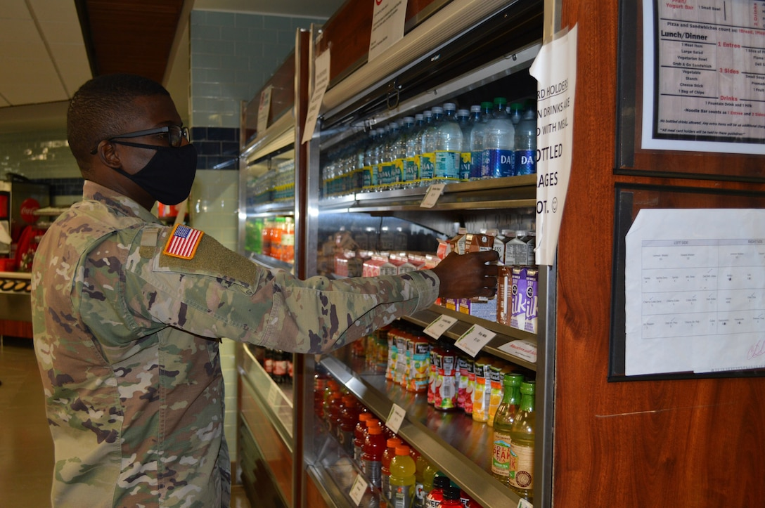 ec. Jean-Rene Louis, a nutrition case specialist in the Department of Nutrition chooses a beverage to go with his meal in the Brooke Army Medical Center dining facility, Dec. 8, 2020. Staff at BAMC's Nutrition Department encourage everyone to focus on eating healthy during the holiday season and throughout the year. (U.S. Army photo by Daniel Calderón)