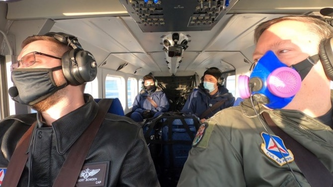 Lt. Col. Robert Bowden, Michigan Wing Civil Air Patrol, and Maj. Rod Rakic, Illinois Wing Civil Air Patrol, fly a mission to distribute COVID vaccine in Michigan while two U.S. Public Health Service officers monitor cooler temperatures in back of the plane. The mission was part of an interagency agreement between the Civil Air Patrol and U.S. Department of Health and Human Services – Indian Health Service. Authorized under the Economy Act, the agreement allowed CAP to act as a Civilian Auxiliary of the Air Force, and fly the vaccine inside a 12-hour period to prevent spoilage.  (Civil Air Patrol photo)