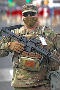 Soldier standing with weapon