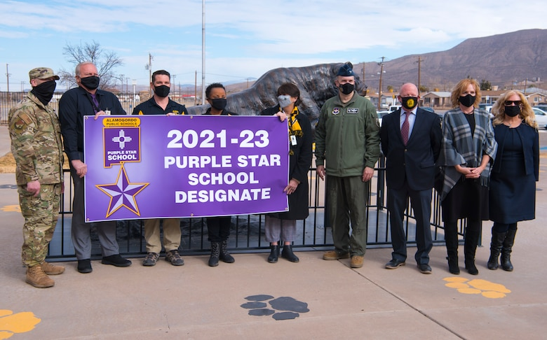 49th Wing leadership and Alamogordo Public School District leadership pose for a photo with Purple Star School Designate banner, Jan. 19, 2021, at Alamogordo, New Mexico. The designation is for two years and it allows the campus to carry the banner of Alamogordo public schools Purple Star on their campus and on its website. (U.S. Air Force photo by Airman 1st Class Jessica Sanchez)