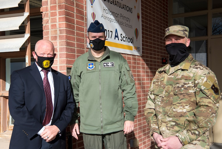 (From left to right) Jerrett Perry, Alamogordo Public School District superintendent, Col. Ryan Keeney, 49th Wing commander and Chief Master Sgt. Thomas Temple, 49th WG command chief, pose for a photo, Jan. 19, 2021, on Holloman Air Force Base, New Mexico. Holloman schools offer programs such as Anchored4Life, Deployed Kids Club and an on-site Military Family Life Counselor to support the unique culture of being a military child. (U.S. Air Force photo by Airman 1st Class Jessica Sanchez)