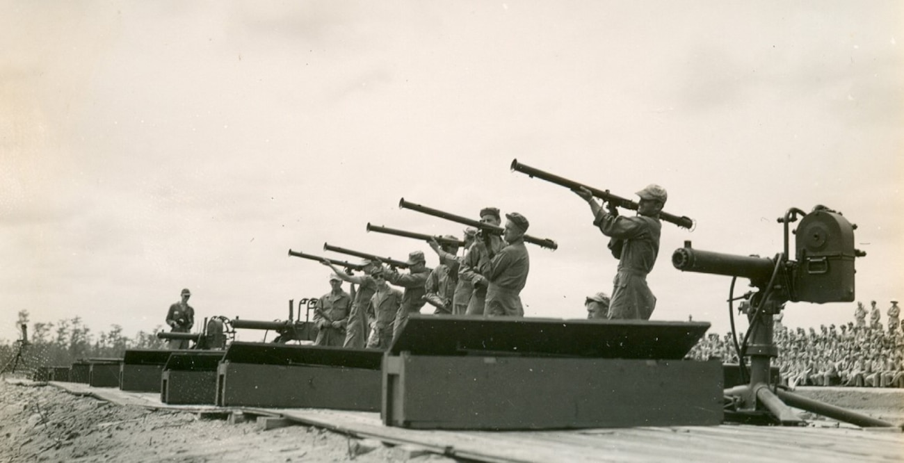 Photo of 1940s bazookas and flame thrower in action