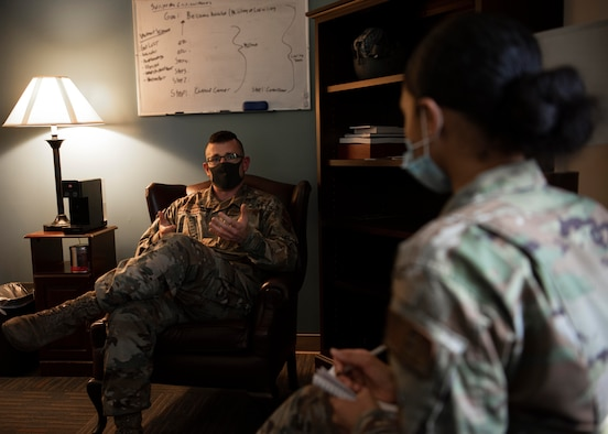 Capt. Kevin Malina, 36th Medical Operations Squadron mental health provider, speaks with an Airman during a session in his office at Andersen Air Force Base, Guam, Jan. 28, 2021. Over the past 56 years, the Biomedical Science Corps has undergone changes, adapted, and innovated to provide the best care possible for the Airmen they service. (U.S. Air Force photo by Senior Airman Aubree Owens)