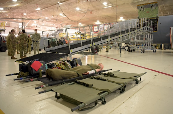 Medical technicians from the 375th Medical Group prepare to transport litters up a newly constructed Patient Loading System at Scott Air Force Base, Illinois, Jan. 26, 2021. The PLS is a portable and constructable ramp used to safely on- and off-load patients to high-deck aircraft, such as the KC-10 Extender, KC-46 Pegasus and KC-135 Stratotanker. (U.S. Air Force photo by Master Sgt. R.J. Biermann)