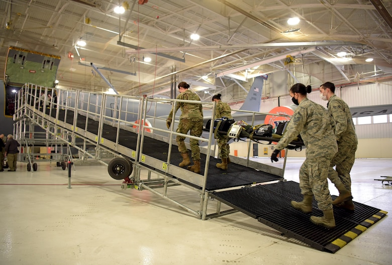 Medical technicians from the 375th Medical Group transport litters up a newly constructed Patient Loading System at Scott Air Force Base, Illinois, Jan. 26, 2021. The PLS is a portable and constructable ramp used to safely on- and off-load patients to high-deck aircraft, such as the KC-10 Extender, KC-46 Pegasus and KC-135 Stratotanker. (U.S. Air Force photo by Master Sgt. R.J. Biermann)