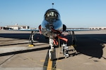 A T-38 Talon sits under the hardstand at Whiteman Air Force Base, Missouri, Jan. 12, 2021.  The Fiscal Year 2024 Defense Logistics Agency Military Construction project will enable R-12 refueling of T-38 aircraft near their parking apron with the new aircraft hydrant outlet pits. (U.S. Air Force photo by Airman 1st Class Christina Carter)