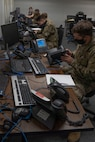 U.S. Air Force Airman Thatcher LaPrise, 338th Training Squadron student, practices connecting a phone to a network in Bryan Hall at Keesler Air Force Base, Mississippi, on Jan. 26, 2021. The 338th TRS has been working towards a modular curriculum, which enables students to receive the training tailored to their future assignment, for approximately five years. (U.S. Air Force photo by Airman 1st Class Kimberly L. Mueller)