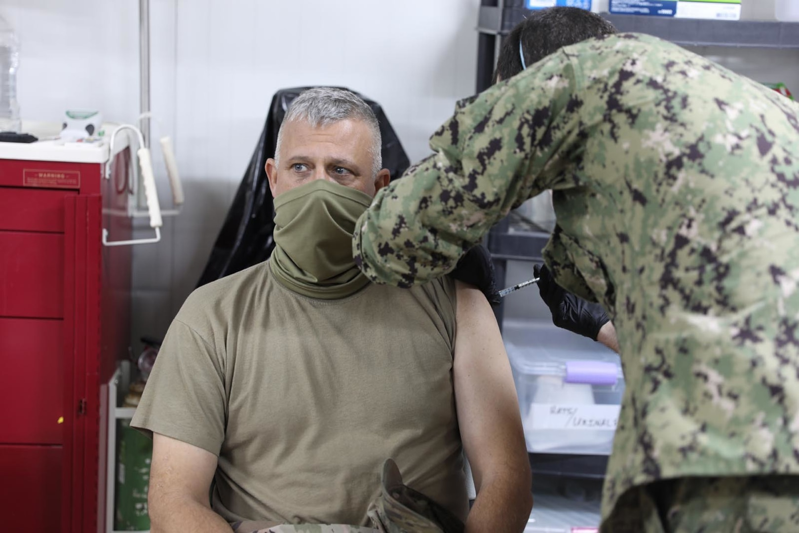 U.S. Army Col. Scott Desormeaux, brigade commander of the Louisiana National Guard's 256th Infantry Brigade Combat Team, receives the COVID-19 vaccine at Erbil Air Base, Iraq, Jan.18, 2021. Combined Joint Task Force-Operation Inherent Resolve (CJTF-OIR) received 300 vaccines for the Combined Joint Operations Area, 110 of those were administered at EAB.